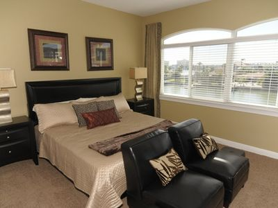 Master Suite with King sized bed boasts a wall of windows overlooking water!