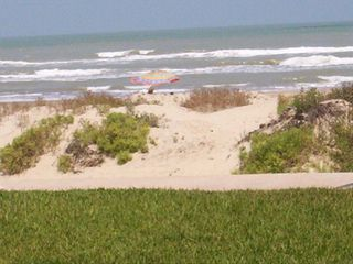 South Padre Island condo photo - View of the beach and ocean from the patio.
