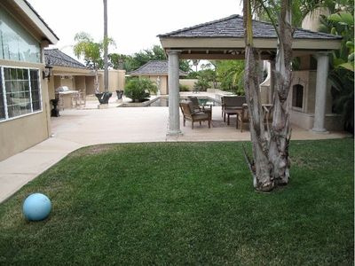 Backyard with fish water feature, exterior full bathroom, barbeque and wet bar!!