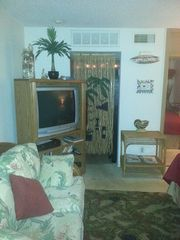 Living area with entry into kitchen area through bead curtain. - Corpus Christi condo vacation rental photo
