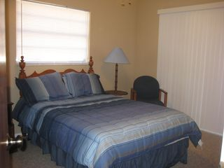 Port Charlotte house photo - Master Bedroom with Double Bed and Sliding Door to Screened Porch.