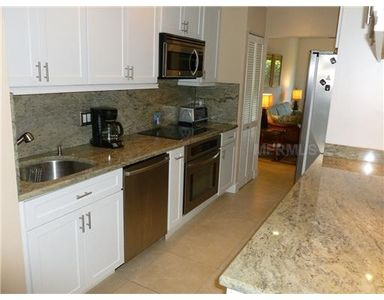 Updated, spacious kitchen w/granite countertops and stainless steal appliances