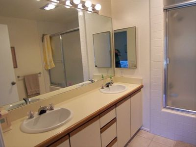 En-suite bathroom has a shower/tub combination and two sinks.