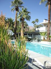 Palm Springs condo photo - Community pool with balcony on right.