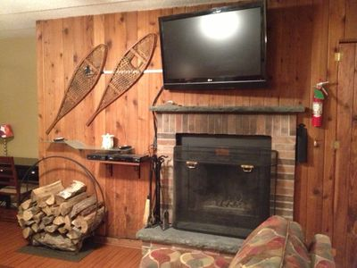 Hi definition TV with wood burning fireplace