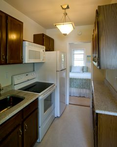 Kitchen has granite countertops, microwave, coffee, etc.