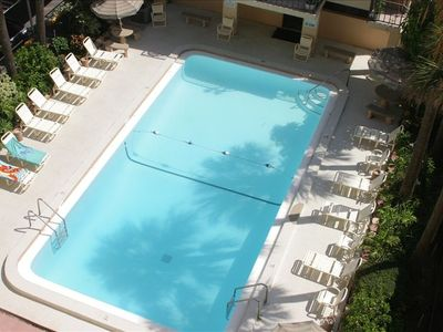 The large, heated pool from the Balcony of your unit!
