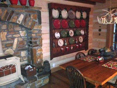 Fabulous pine dining table, antique chairs, enjoying a majestic rock fireplace