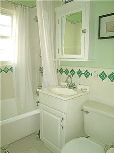 Spotless bathroom with Shower/Tub combo comes with towels and all linens