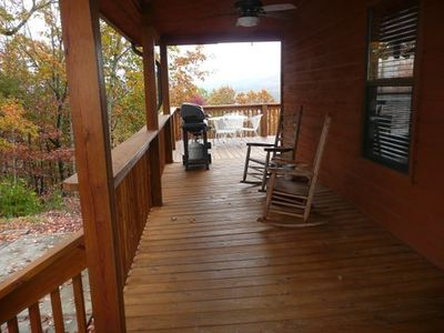 Covered front deck w/ grill, hot tub and rocking chairs . . .