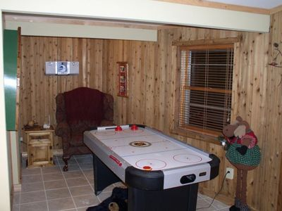 Game room with flat screen TV, CD stereo, air hockey and more..