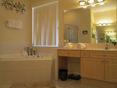 Very spacious master bathroom with tub and walk in shower.