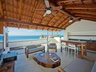 Puerto Vallarta condo photo - Cosy shaded area ft: internet,sat tv,kitchen bar,stove,sink,grill,shower & bath