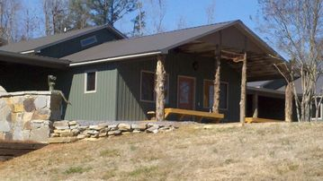Guntersville Lake cabin rental - Cabin has a large front porch with view of Lake Guntersville.