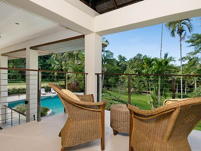 Balcony off Bedroom 1 overlooking pool, lawns and gardens