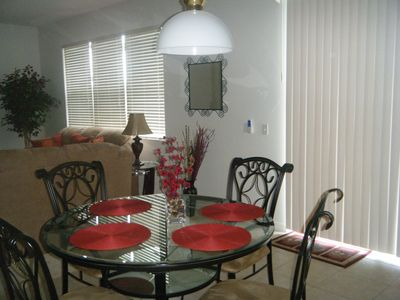 Kitchen table with family room in background