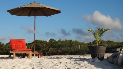 Teak beach lounger & umbrella for some shade, all it's missing is you!