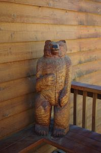 Carved Charney Bear greets all of our guests with a friendly hello