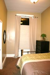 San Francisco apartment photo - Another view of bedroom with large window, dresser, mirror and very high ceiling