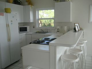 St George Island house photo - Kitchen. You will be cooking and watching the Gulf.