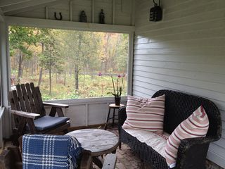 Screened-in Porch with WiFi overlooking the field and forest. - Hudson Highlands farmhouse vacation rental photo