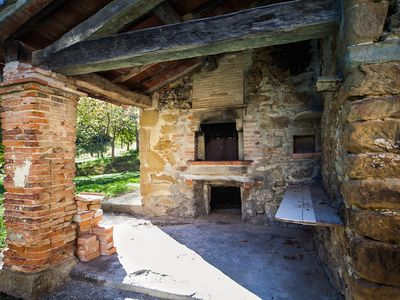 Original outdoor stone oven. (hint: pizza)