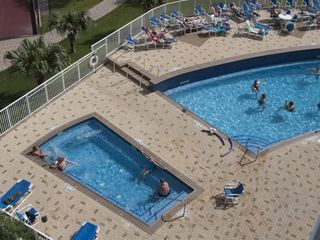 South Padre Island condo photo - View of the giant hot tub and the pool. Pool is heated in the winter.