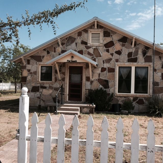 Our Norse Rock House is family and pet friendly & With a white picket fence!