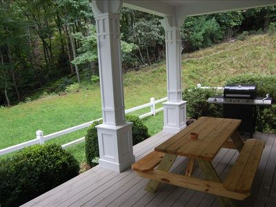 Grill and picnic area protected by porch