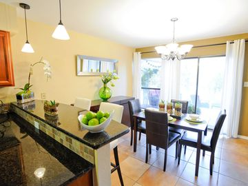 Austin townhome rental - Newly remodeled kitchen cabinets and counter tops looking into the dining room