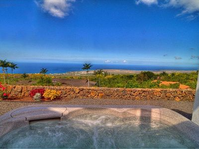 Relax in the hot tub in this private setting below the pool - what a view!
