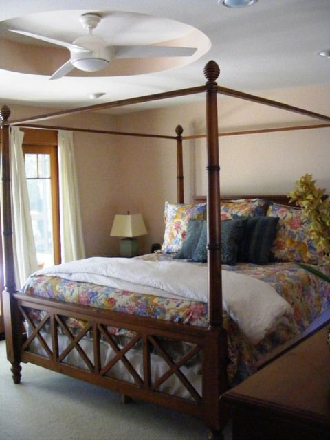 Master bedroom furnished w/ King bed, attached bathroom & home office.