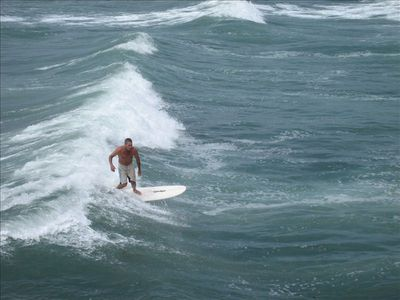 surfer from pier