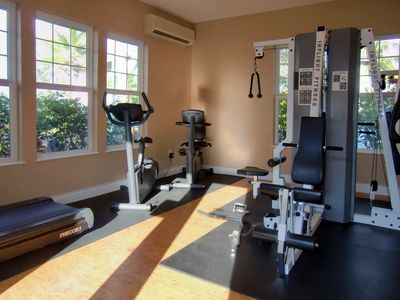 Air-conditioned fitness room with HDTV for your use in Waikoloa Colony Villas