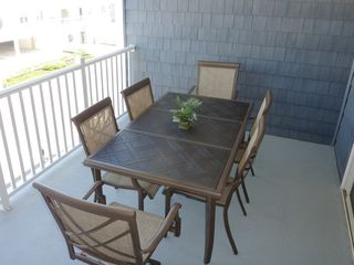 Wildwood Crest condo photo - large covered balcony with dining set