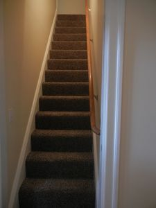 Stairs that lead up to the upstairs bedroom and bathroom.