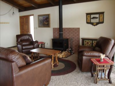 Relax in the comfortable living room with a cozy fire place
