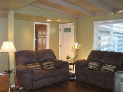 Sectional couches open up to 4 recliners
