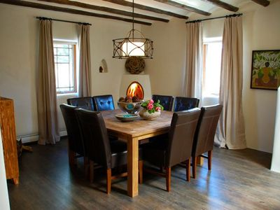 Santa Fe house rental - Main house dining room off kitchen with table that seats eight.