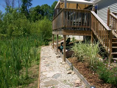 Boyne City house rental - Walkway from fire pit to water spigot
