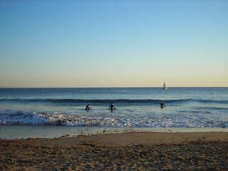 Santa Cruz house photo - Local and visiting surfers catch an evening ride at 21st Ave Beach!