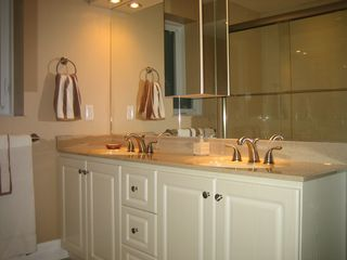 Ottawa house photo - Ensuite bathroom for master bedroom has double sinks and tub/shower.