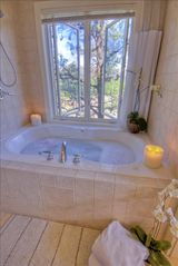Sedona condo photo - Spacious Two-Person Whirlpool Tub/Shower with Travertine Tile