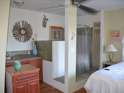 View of partial kitchen and Bathroom in pool cabana.