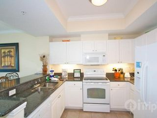 Gulf Shores condo photo - Fully equipped kitchen with granite counter tops