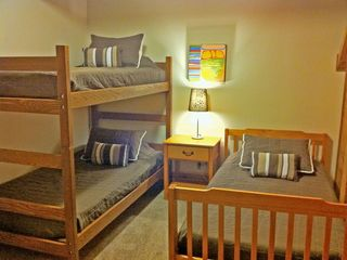 Left: The upstairs left bedroom has a bunk bed and twin bed. Sleeps three.
