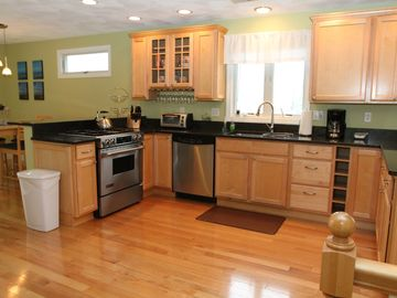 Open concept kitchen w/granite counters and stainless steel appliances