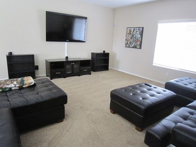 This family room is awesome.. large TV-comfy couches - someone get the popcorn!!