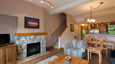 Open Concept Living Area with Gas Fireplace and Flat Screen TV
