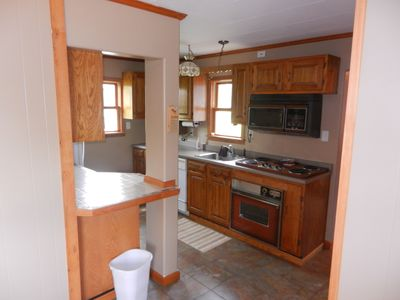 Kitchen - microwave, stove, oven, dishwasher, refrigerator, coffee maker.